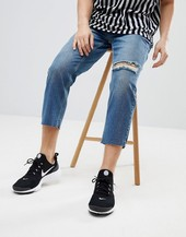 Mennace Tapered Jeans In Midwash Blue With Knee Rip