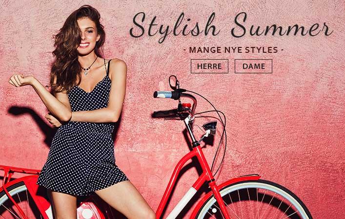 Jente i sommerkjole foran en rød sykkel. Stylish Summer, mange sommerklær